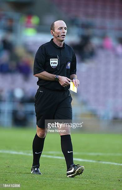 Referee Mike Dean in action during the Sky Bet League One match between Coventry City and Sheffield United at Sixfields Stadium on October 13 2013 in...