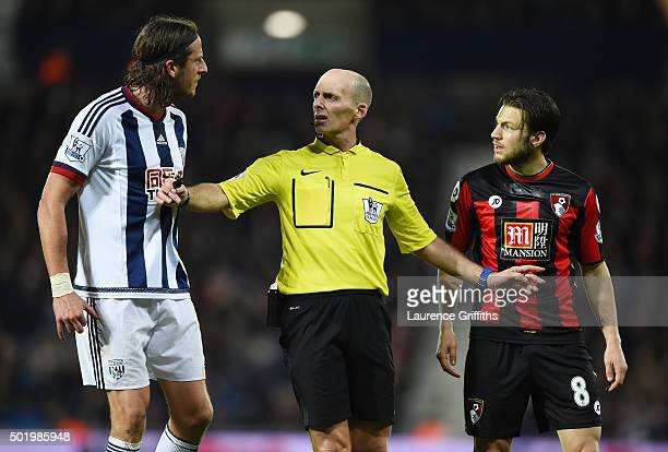 Referee Mike Dean intervenes between Jonas Olsson of West Bromwich Albion and Harry Arter of Bournemouth during the Barclays Premier League match...