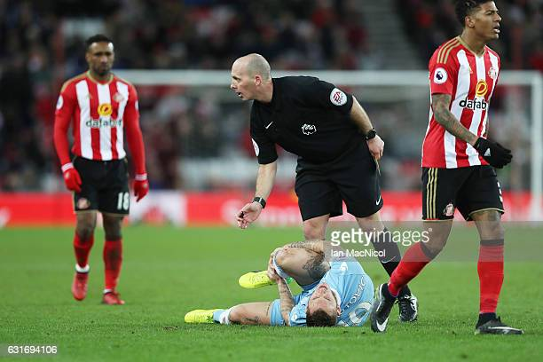 Referee Mike Dean is seen during the Premier League match between Sunderland and Stoke City at Stadium of Light on January 14 2017 in Sunderland...