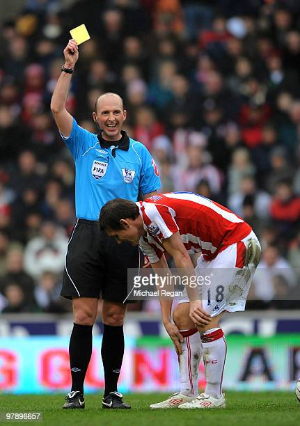 Referee Mike Dean laughs as he gives Dean Whitehead of Stoke his first yellow card in the first half of the Barclays Premiership match between Stoke...
