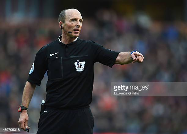 Referee Mike Dean looks on during the Barclays Premier League match between Burnley and Arsenal at Turf Moor on April 11 2015 in Burnley England