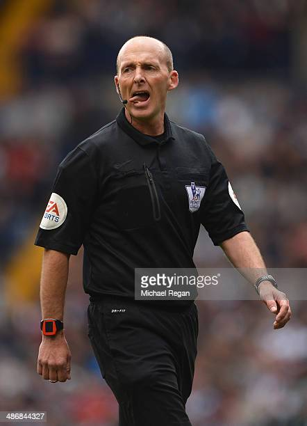 Referee Mike Dean looks on during the Barclays Premier League match between West Bromwich Albion and West Ham United at The Hawthorns on April 26...