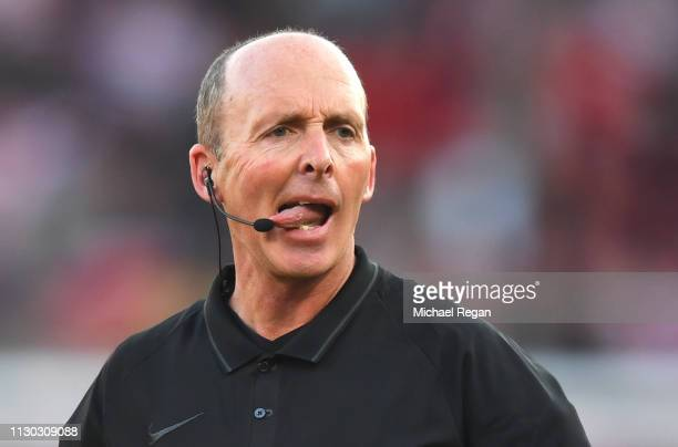 Referee Mike Dean looks on during the FA Cup Fifth Round match between Doncaster Rovers and Crystal Palace at Keepmoat Stadium on February 17 2019 in...