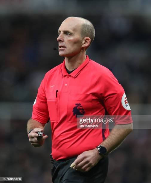Referee Mike Dean looks on during the Premier League match between Newcastle United and Wolverhampton Wanderers at St James Park on December 9 2018...