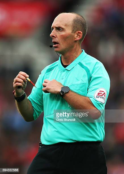Referee Mike Dean looks on during the Premier League match between Stoke City and Manchester City on August 20 2016 in Stoke on Trent England