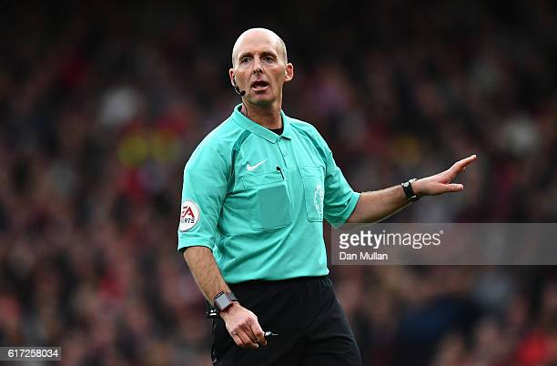 Referee Mike Dean looks on during the Premier League match between Arsenal and Middlesbrough at Emirates Stadium on October 22 2016 in London England