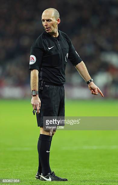 Referee Mike Dean looks on during the Premier League match between West Ham United and Manchester United at London Stadium on January 2 2017 in...