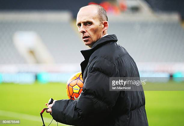 Referee Mike Dean looks on prior to the Barclays Premier League match between Newcastle United and Manchester United at St James' Park on January 12...