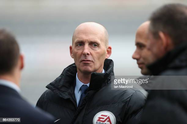 Referee Mike Dean looks on prior to the Premier League match between Newcastle United and Crystal Palace at St James Park on October 21 2017 in...