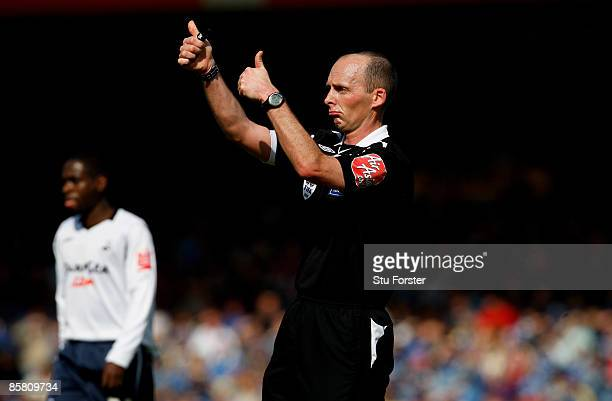 Referee Mike Dean makes a decision during the Coca Cola Championship match between Cardiff City and Swansea City at Ninian Park on April 5 2009 in...