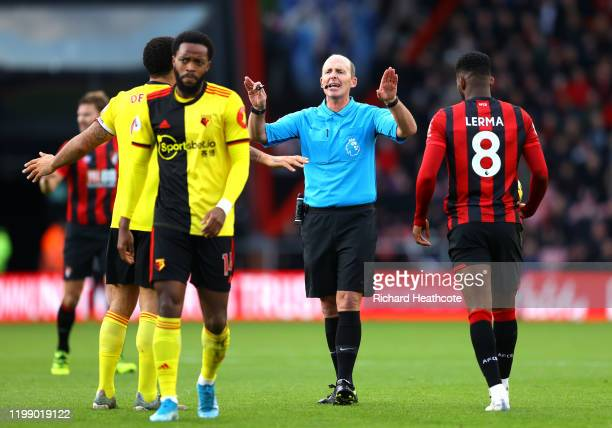 Referee Mike Dean makes a decision during the Premier League match between AFC Bournemouth and Watford FC at Vitality Stadium on January 12 2020 in...