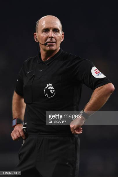 Referee Mike Dean officiates the English Premier League football match between Burnley and Manchester United at Turf Moor in Burnley north west...