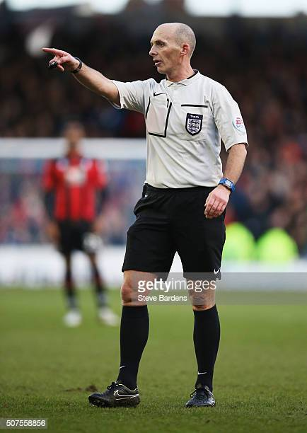 Referee Mike Dean points during the Emirates FA Cup Fourth Round match between Portsmouth and AFC Bournemouth at Fratton Park on January 30 2016 in...