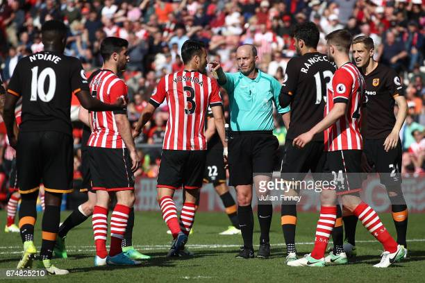 Referee Mike Dean points to the penalty spot to award Southampton a penalty during the Premier League match between Southampton and Hull City at St...