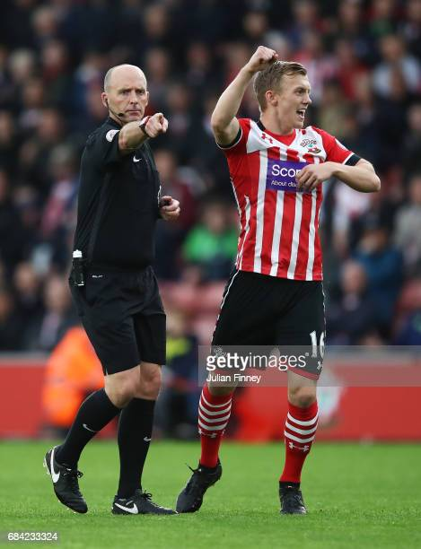 Referee Mike Dean points to the spot as James WardProwse of Southampton celebrates during the Premier League match between Southampton and Manchester...