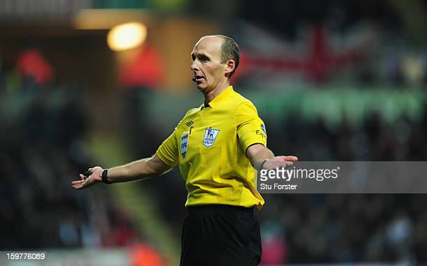 Referee Mike Dean reacts during the Barclays Premier League match between Swansea City and Stoke City at Liberty Stadium on January 19 2013 in...
