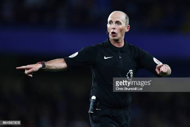Referee Mike Dean reacts during the Premier League match between Chelsea and Manchester City at Stamford Bridge on April 5 2017 in London England