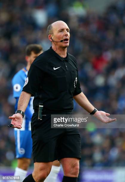 Referee Mike Dean reacts during the Premier League match between Brighton and Hove Albion and Swansea City at Amex Stadium on February 24 2018 in...