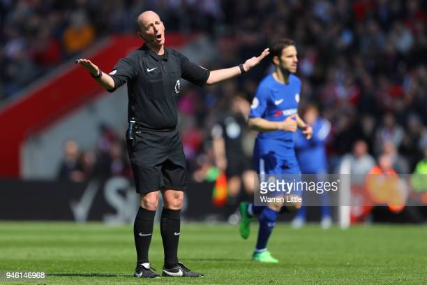 Referee Mike Dean reacts during the Premier League match between Southampton and Chelsea at St Mary's Stadium on April 14 2018 in Southampton England