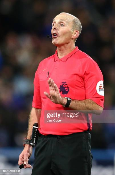 Referee Mike Dean reacts during the Premier League match between Huddersfield Town and Burnley FC at John Smith's Stadium on January 2 2019 in...