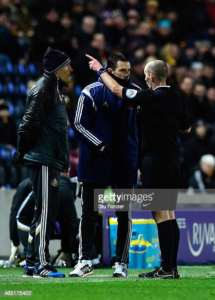 Referee Mike Dean sends Sunderland manager Gus Poyet to the stand during the Barclays Premier League match between Hull City and Sunderland at KC...