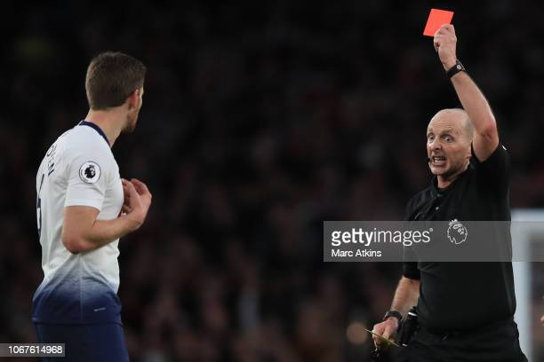 Referee Mike Dean shows a red card to Jan Vertonghen of Tottenham Hotspur during the Premier League match between Arsenal FC and Tottenham Hotspur at...