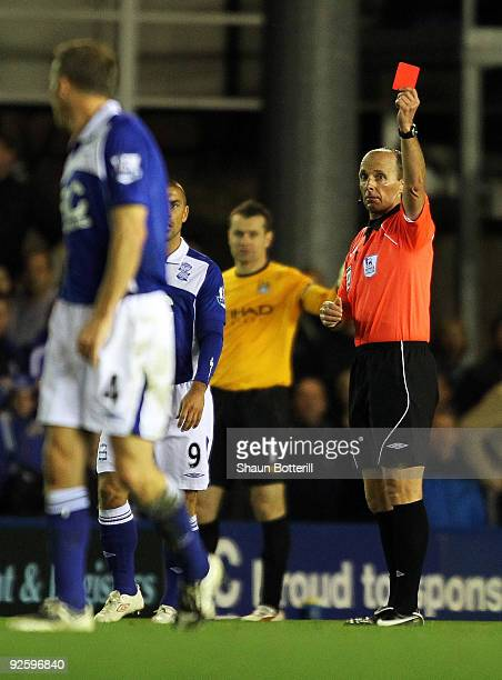 Referee Mike Dean shows Barry Ferguson a red card during the Barclays Premier League match between Birmingham City and Manchester City at St Andrews...
