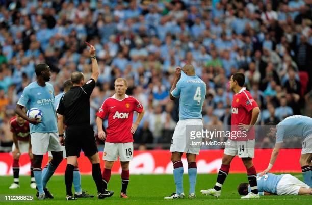 Referee Mike Dean shows Paul Scholes a red card after his high footed challenge Pablo Zabaleta of Manchester City during the FA Cup sponsored by EON...
