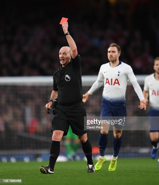 Referee Mike Dean shows the red card during the Premier League match between Arsenal FC and Tottenham Hotspur at Emirates Stadium on December 2 2018...