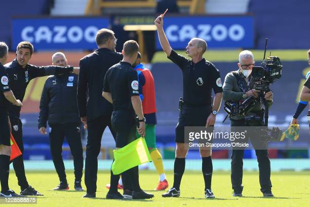 Referee Mike Dean shows West Brom manager Slaven Bilic a red card and sends him off at half-time during the Premier League match between Everton and...