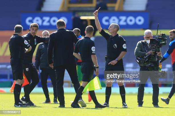 Referee Mike Dean shows West Brom manager Slaven Bilic a red card and sends him off at halftime during the Premier League match between Everton and...