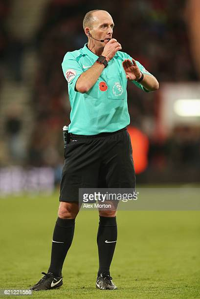 Referee Mike Dean signals during the Premier League match between AFC Bournemouth and Sunderland at Vitality Stadium on November 5 2016 in...