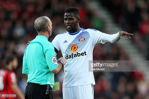 Referee Mike Dean speaks to Papy Djilobodji of Sunderland during the Premier League match between AFC Bournemouth and Sunderland at Vitality Stadium...