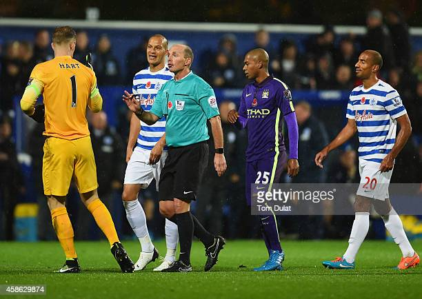 Referee Mike Dean talks to Joe Hart of Manchester City as Charlie Austin's goal is disallowed during the Barclays Premier League match between Queens...