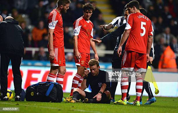 Referee Mike Jones after being accidentally knocked over during the Barclays Premier League match between Newcastle United and Southampton at St...