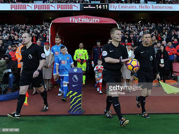 Referee Mike Jones collects the ball with his assistants Mark Scholes and Adrian Holmes before the Premier League match between Arsenal and AFC...