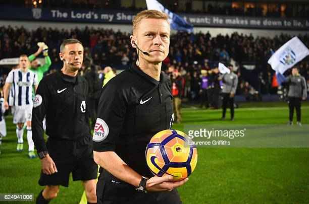 Referee Mike Jones collects the match ball prior to during the Premier League match between West Bromwich Albion and Burnley at The Hawthorns on...