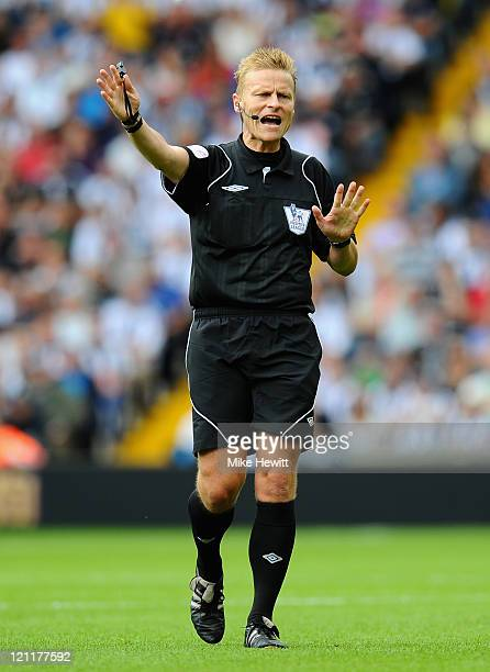 Referee Mike Jones during the Barclays Premier League match between West Bromwich Albion and Manchester United at The Hawthorns on August 14 2011 in...