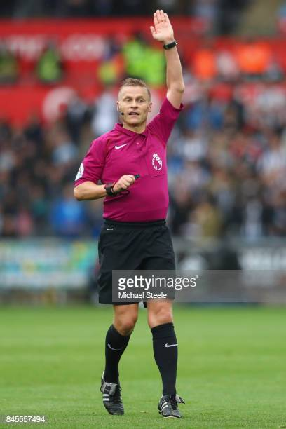 Referee Mike Jones during the Premier League match between Swansea City and Newcastle United at Liberty Stadium on September 10 2017 in Swansea Wales