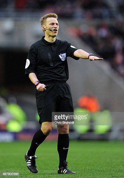 Referee Mike Jones gestures during the Barclays Premier League match between Sunderland and Hull City at Stadium of Light on February 08 2014 in...