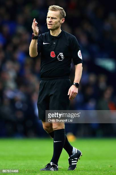 Referee Mike Jones gestures during the Premier League match between West Bromwich Albion and Manchester City at The Hawthorns on October 28 2017 in...
