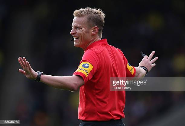 Referee Mike Jones gives a decision during the Barclays Premier League match between Norwich City and Liverpool at Carrow Road on September 29 2012...