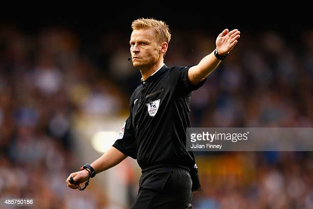 Referee Mike Jones gives a decision during the Barclays Premier League match between Tottenham Hotspur and Everton at White Hart Lane on August 29...