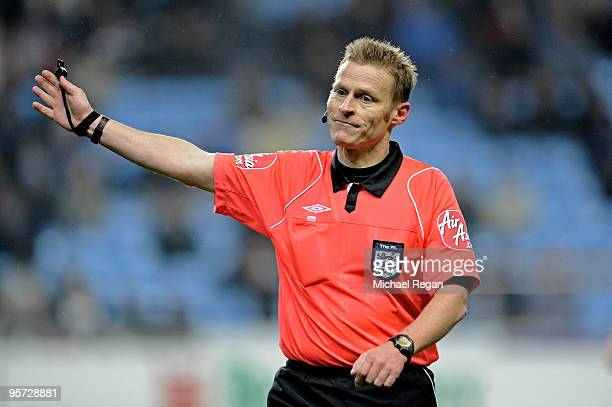 Referee Mike Jones gives a decision during the FA Cup sponsored by EON 3rd round replay match between Coventry City and Portsmouth at the Ricoh Arena...