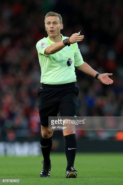 Referee Mike Jones gives instructions during the Premier League match between Liverpool and Southampton at Anfield on November 18 2017 in Liverpool...