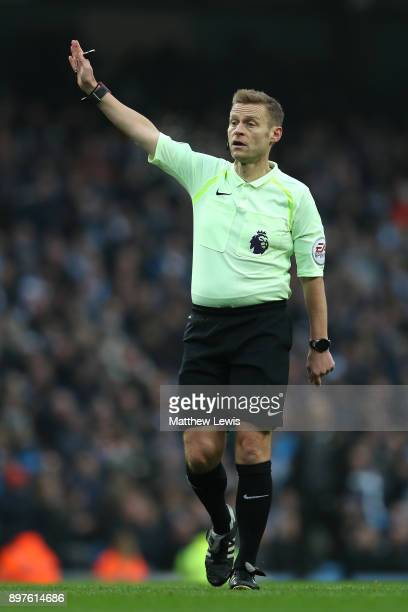 Referee Mike Jones gives instructions during the Premier League match between Manchester City and AFC Bournemouth at Etihad Stadium on December 23...