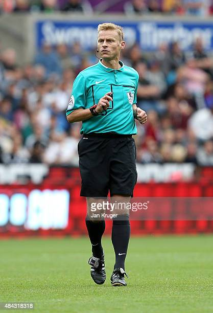 Referee Mike Jones looks on during the Barclays Premier League match between Swansea City and Newcastle United at Liberty Stadium on August 15 2015...