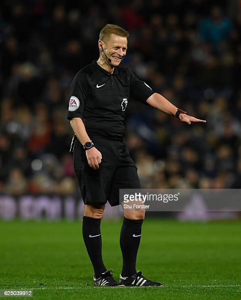 Referee Mike Jones raises a smile during the Premier League match between West Bromwich Albion and Burnley at The Hawthorns on November 21 2016 in...