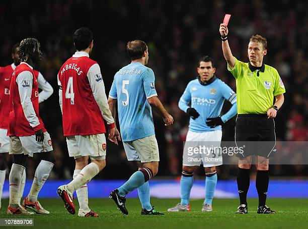 Referee Mike Jones sends off Pablo Zabaleta of Manchester City and Bacary Sagna of Arsenal during the Barclays Premier League match between Arsenal...