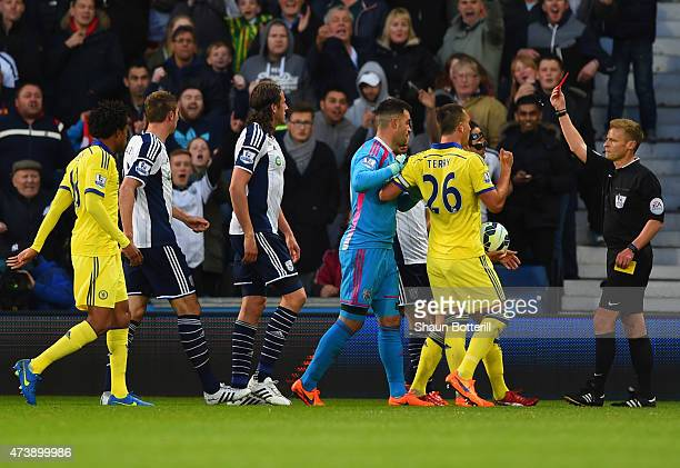 Referee Mike Jones shows a red card to Cesc Fabregas of Chelsea as he is sent off during the Barclays Premier League match between West Bromwich...